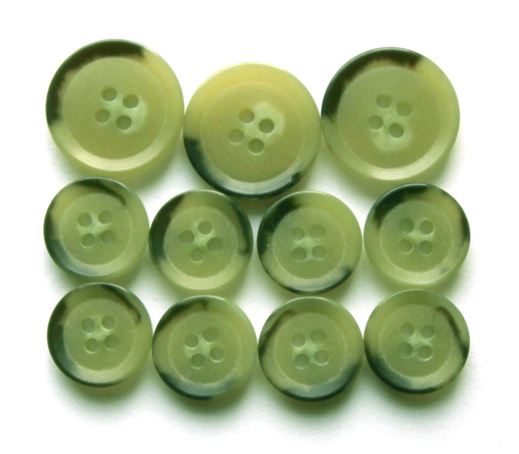Green tint composite jacket buttons